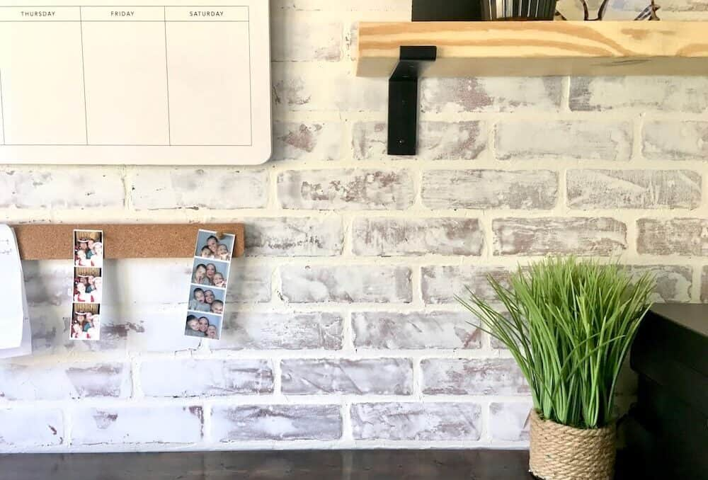 close up of a whitewashed brick wall in a home office