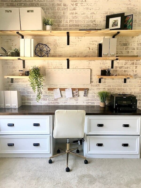 home office with a whitewashed brick accent wall