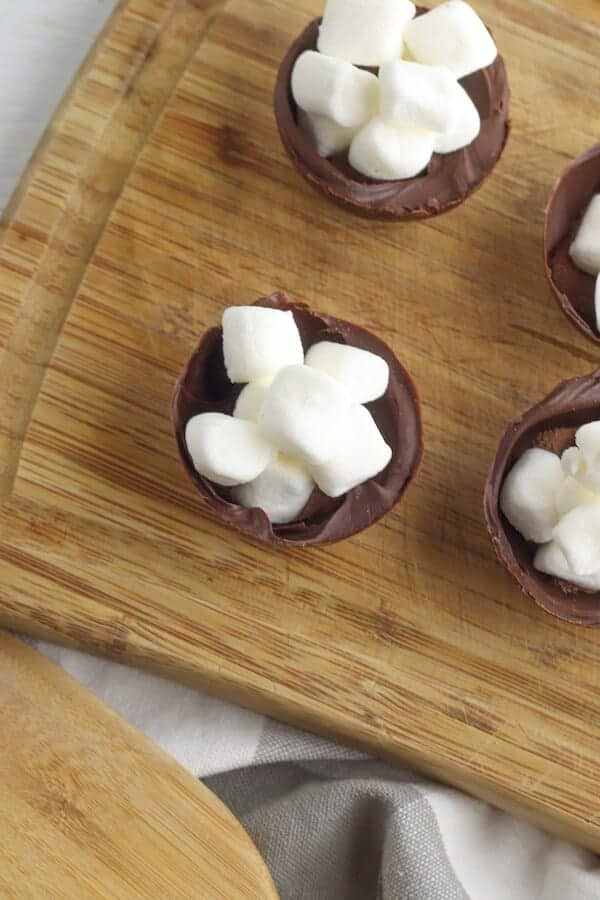 hot cocoa mix and marshmallows in hot chocolate bombs