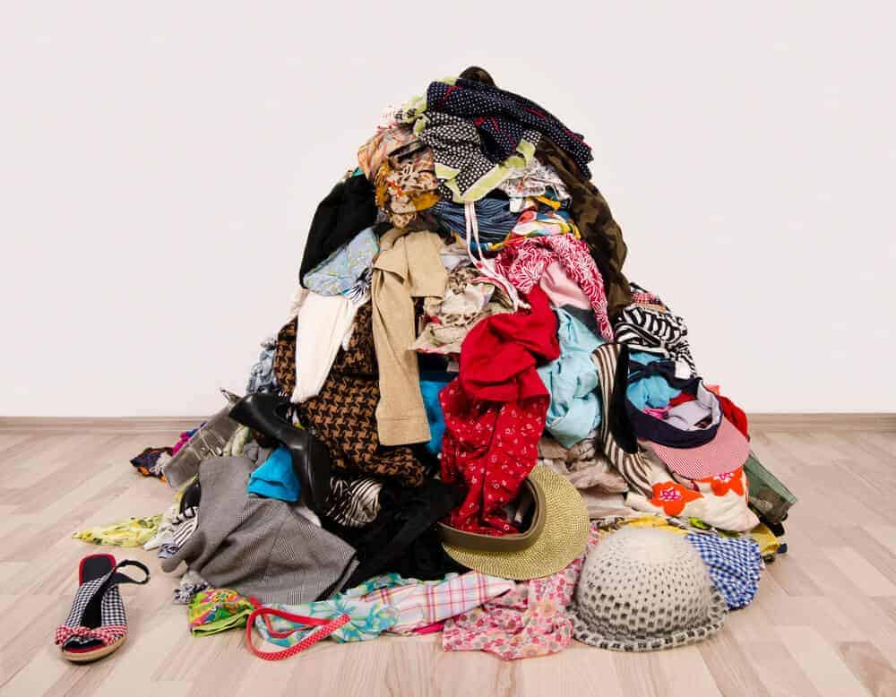 big pile of clothing clutter on the floor