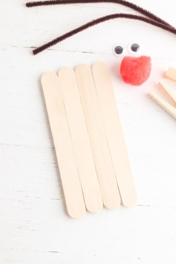 large popsicle sticks lined up on a table