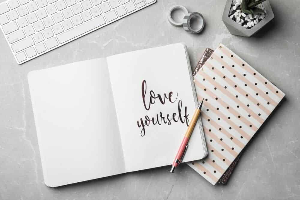 self care planner on a desk that says love yourself