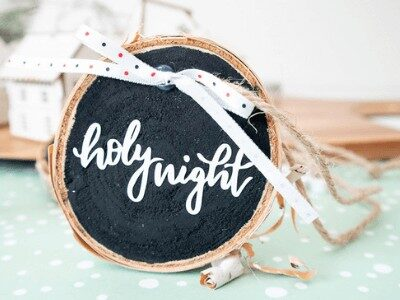 DIY wood slice ornament that says holy night