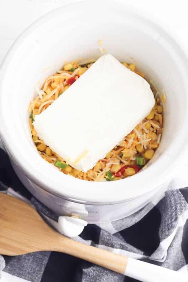 ingredients for fiesta corn dip in a crock pot