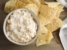 fiesta corn dip in a serving bowl with tortilla chips