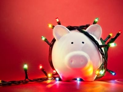 piggy bank with Christmas lights around it