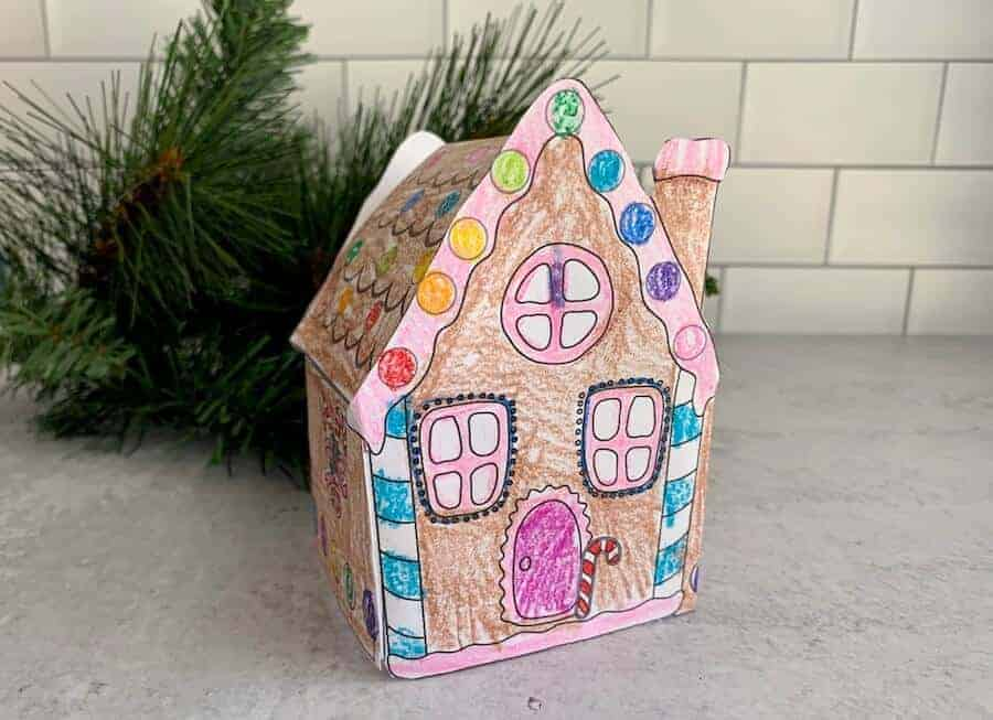 3D paper gingerbread house craft on a table