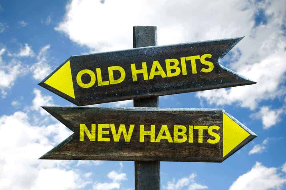 sign that says old habits and new habits