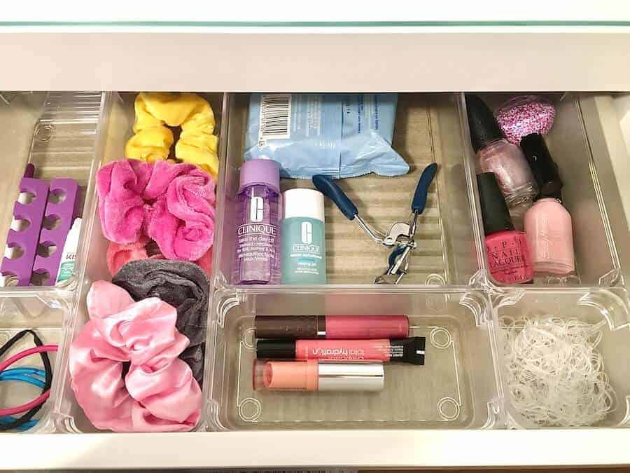 organized junk drawer with clear acrylic organizers