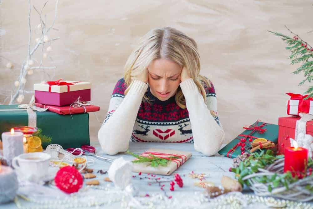 woman stressed out about Christmas gifts
