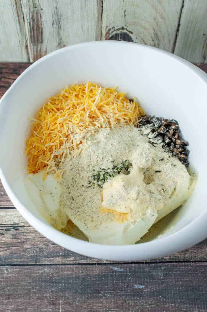 ingredients for olive cheeseball in a bowl