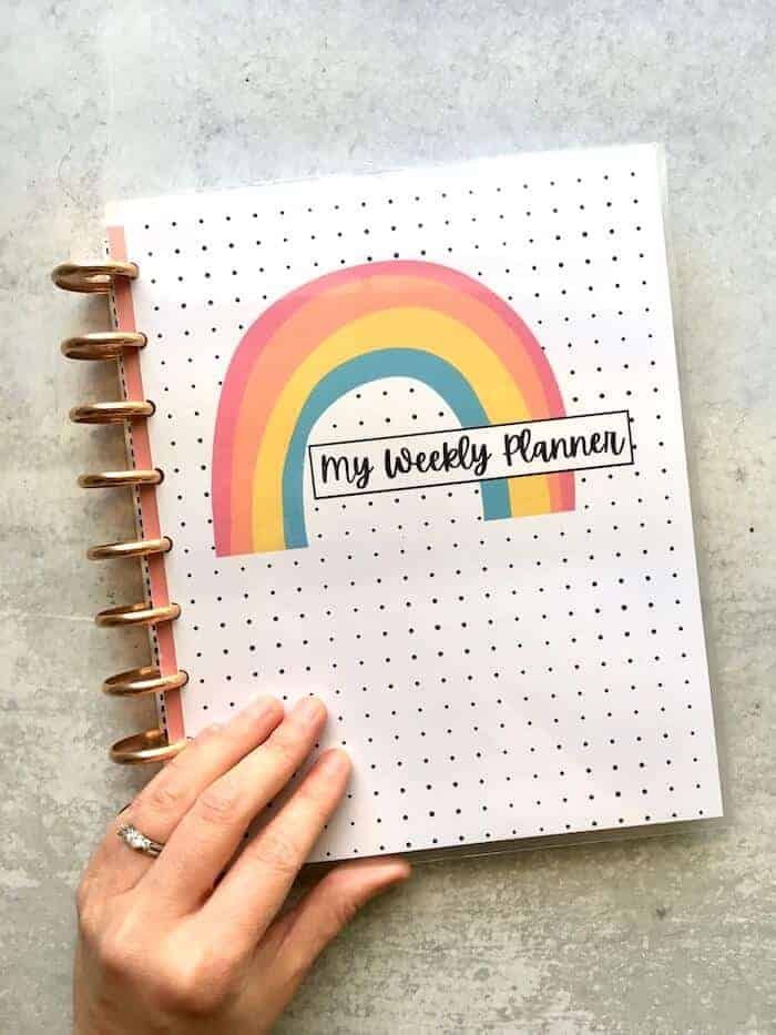finished DIY planner cover with a rainbow and polka dots