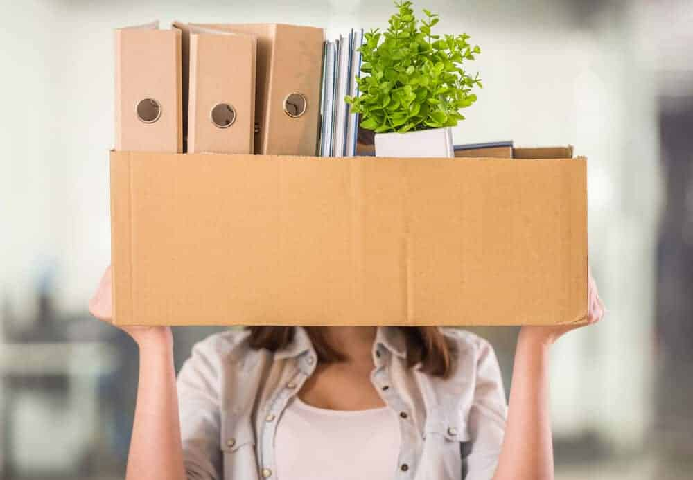 woman holding a box of clutter