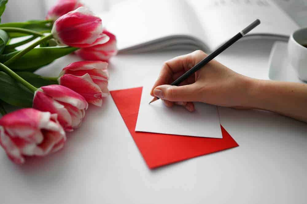 woman writing a love letter for husband