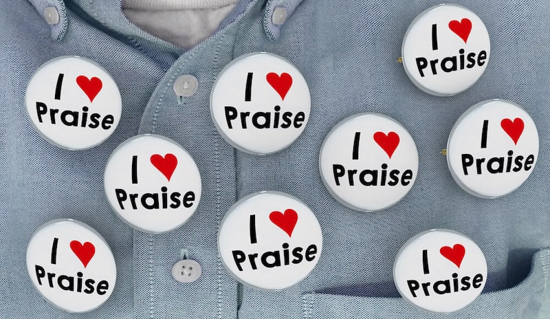 buttons that say I love praise on a man's shirt