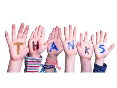kids hands that are painted to say thanks