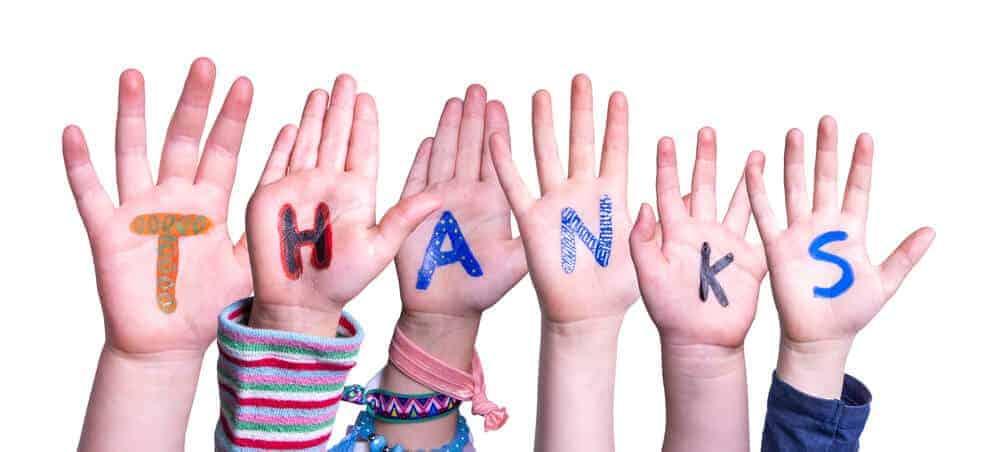 """Thanks"" written on kids hands"