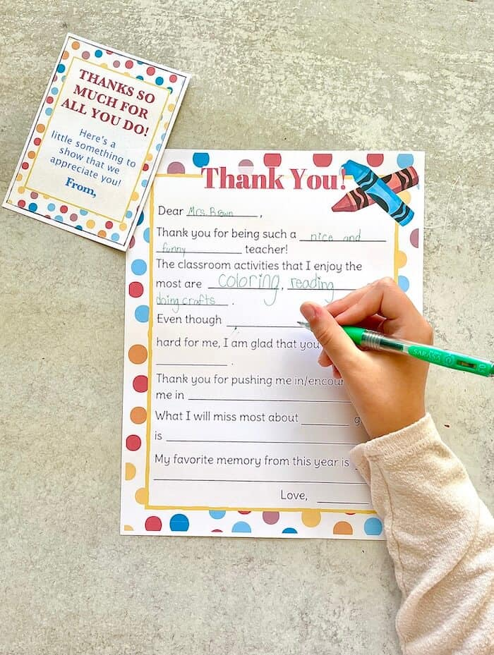 child writing a thank you letter for teacher