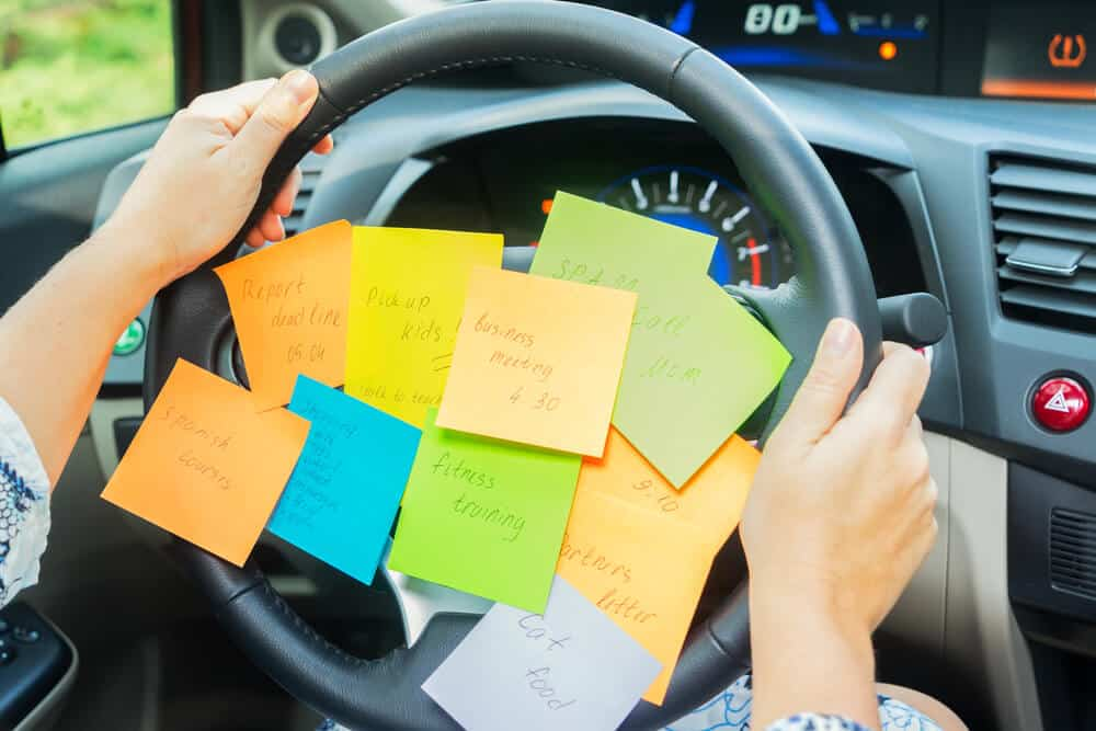 to do list sticky notes on a steering wheel