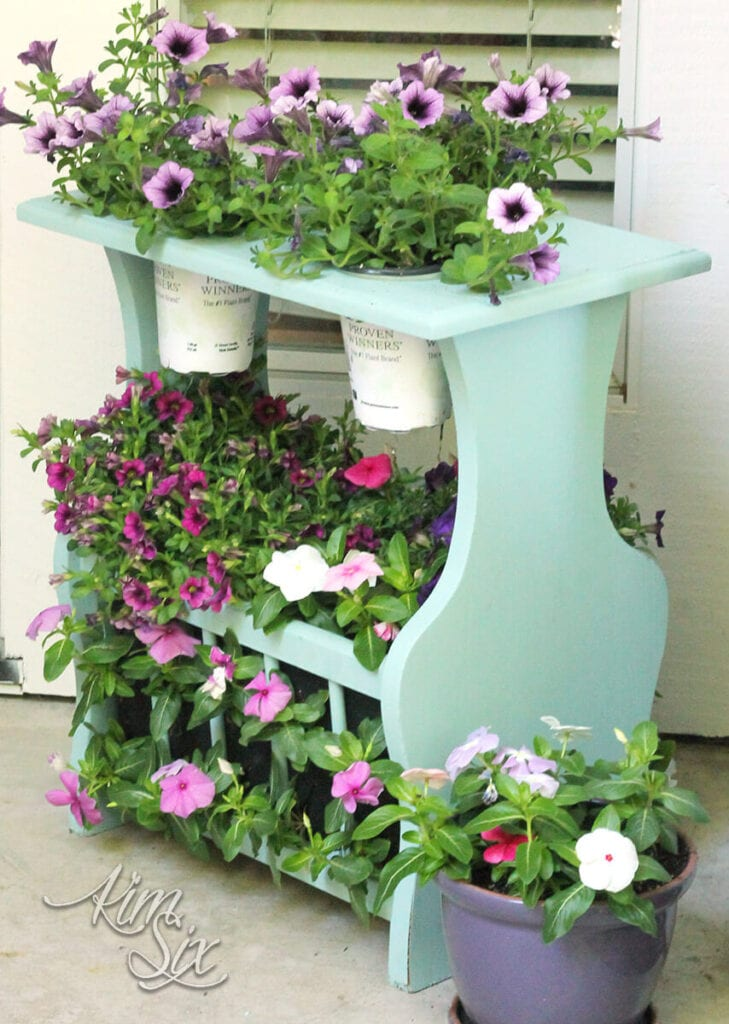 magazine rack repurposed into a plant stand