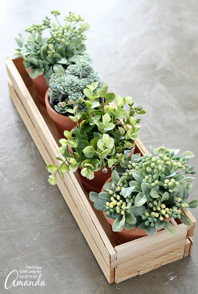 DIY wood planter box with potted plants inside