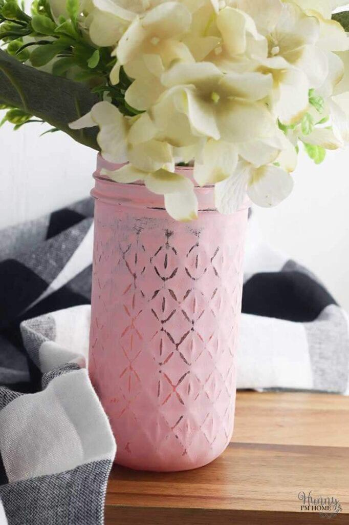 mason jar painted pink used as a vase