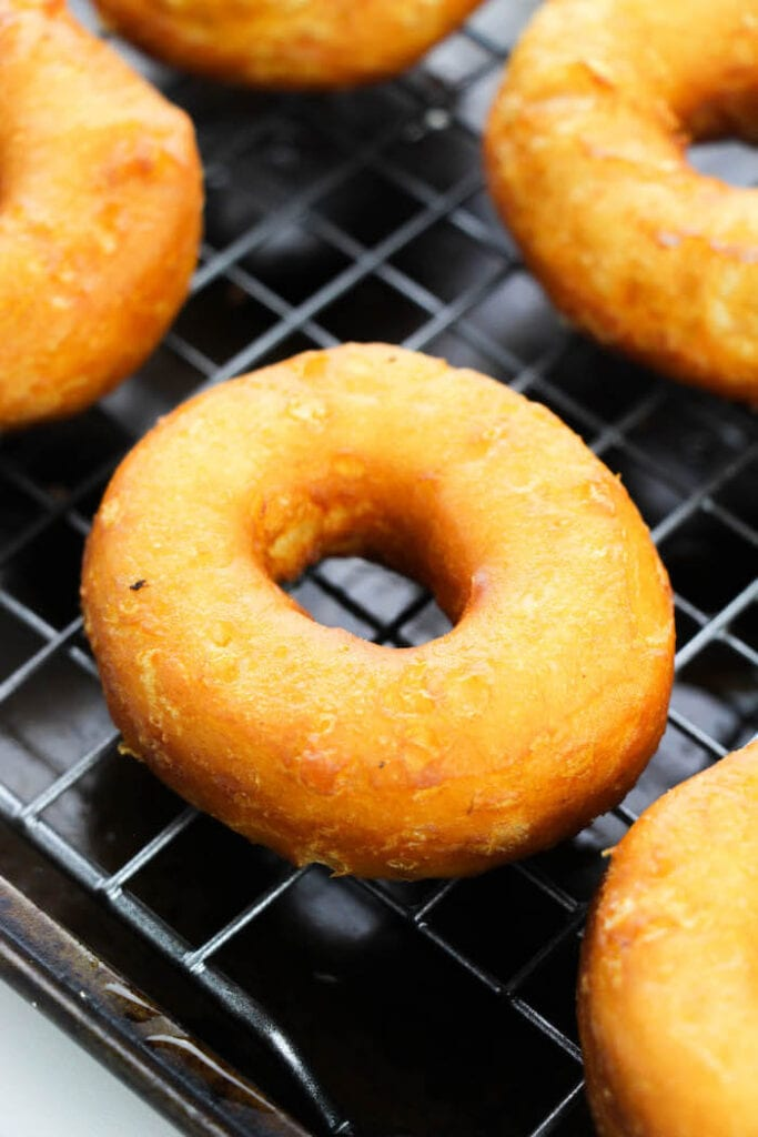 fried biscuit donuts on a wire cooling rack