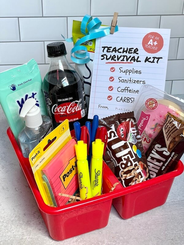 first day of school teacher gift with soda, candy, snacks, and school supplies