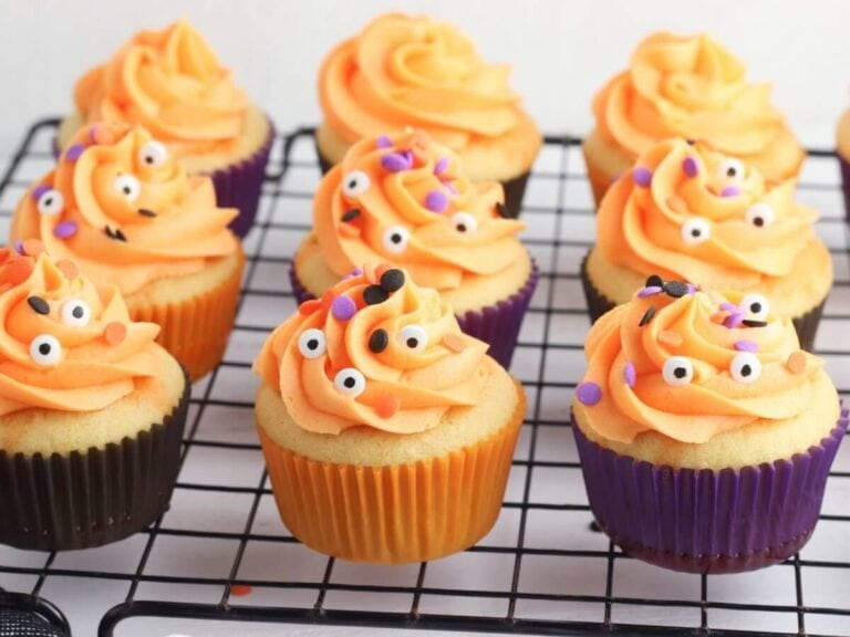 Easy Halloween Poke Cake Cupcakes with Orange Buttercream Icing