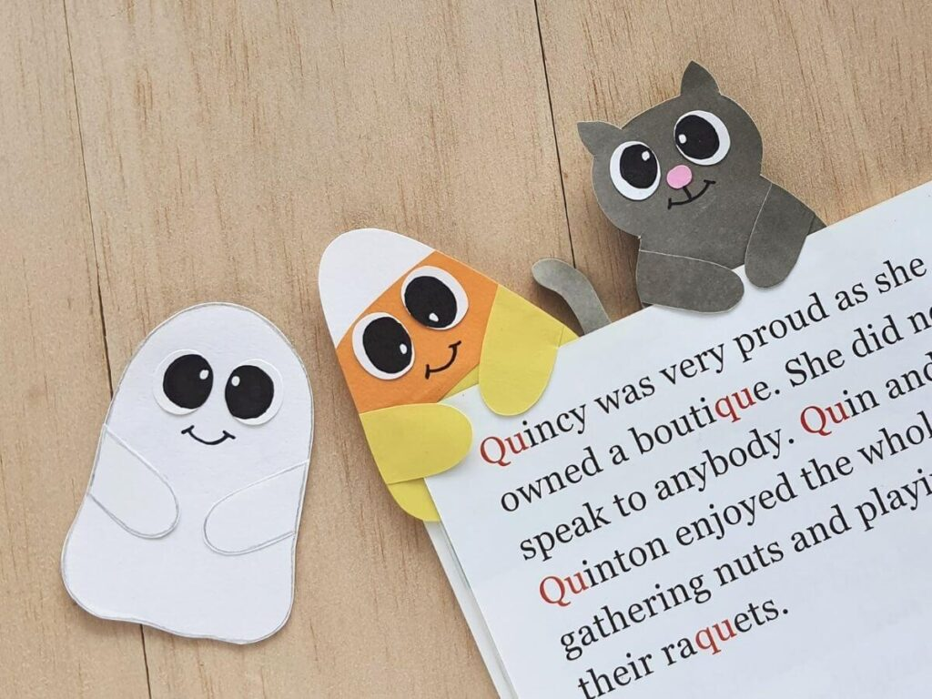 ghost, candy corn, and cat halloween bookmarks to make