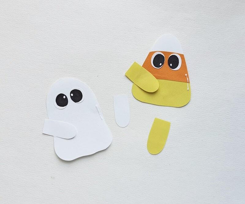 arms being glued on halloween hug bookmarks
