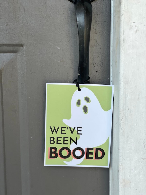 We've been booed printable sign hanging on a front door